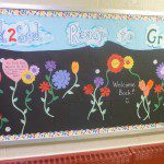 Trinity Art Teacher Mrs. Kerwin welcomes students back to school with a beautiful bulletin board display.