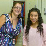 Mrs. Gallo helping her new 7th grade student Sole get her locker for the first day of school.